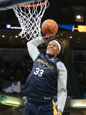 Indiana Pacers forward Myles Turner (33) dunks in a scrimmage game during the Indiana Pacers FanJam at Banker's Life Fieldhouse, Indianapolis, Sunday, Oct. 15, 2017.