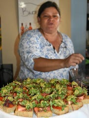 CJ's general manager Laura Owen with bite sized versions of the restaurant's new PLT, or portabella, lettuce and tomato sandwich. CJ's on the Bay was recognized Tuesday afternoon as the first organization on Marco Island to be awarded Blue Zones certification.