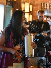 """Maria """"Charis"""" Gutierrez sings with West Side Tropico. Four bands came together in a benefit performance for hurricane relief at Music for Neighbors, October 29 at Whiskey Park restaurant."""