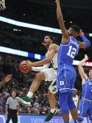 Michigan State's Miles Bridges scores against Duke's Javin DeLaurier during the first half on Tuesday, Nov. 14, 2017, in Chicago.
