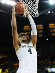 Michigan forward Isaiah Livers (4) dunks in the first half on Sunday, Nov. 26, 2017, at Crisler Center.