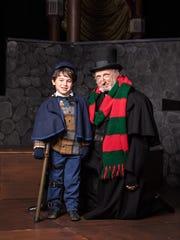 "Ari Bigelman as Tiny Tim and Thomas D. Mahard as Ebenezer Scrooge in Meadow Brook Theatre's ""A Christmas Carol."""