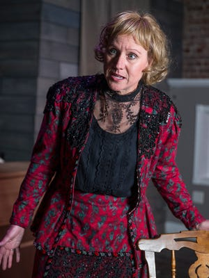 """Kathy Pataluch is photographed in character as lead role madam Ann Kitchen, before rehearsal for """"The Duchess of Stringtown,"""" at Indy Convergence theater, Indianapolis, Tuesday, Dec. 19, 2017. Joanna Kitchen, known as ÒThe Duchess of Stringtown,Ó  who was married six times, ran a brothel on Indianapolis' west side in the 1800s. Her life has inspired a one-act play, ÒThe Duchess of Stringtown,Ó that will be performed Dec. 22 and 23 at Indy Convergence."""