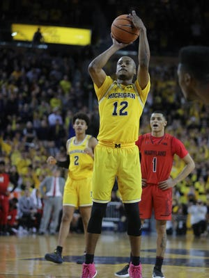 Michigan Muhammad-Ali Abdur-Rahkman sinks the game-winning free throws during U-M's 68-67 win on Monday, Jan. 15, 2018, at Crisler Center.
