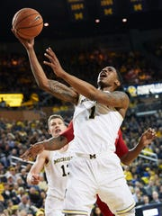 Michigan Wolverines guard Charles Matthews (1) shoots