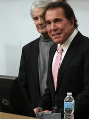 Stephen Wynn, front, speaks to guests with Steven Dezii