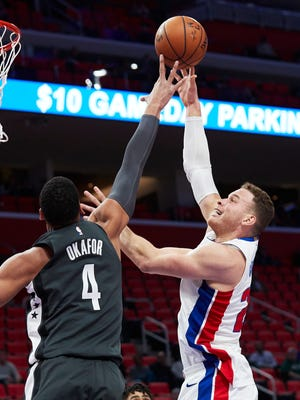 Detroit's Blake Griffin shoots over Brooklyn Nets center Jahlil Okafor in the first half at Little Caesars Arena on Wednesday, Feb. 7, 2018.