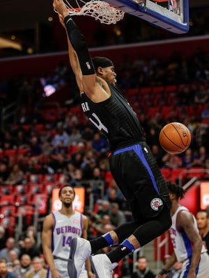 Clippers forward Tobias Harris (34) dunks against Pistons during the first half at the Little Caesars Arena in Detroit, Friday, February 9, 2018.