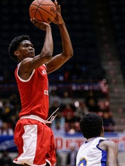 Edison wing Gary Solomon (2) attempts for a 3-pointer against Pershing during the second half of the Detroit Public School League championship game at University of Detroit Mercy in Detroit, Friday, February 16, 2018.