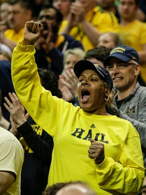 Michigan fans cheer for the Wolverines during second half of second round of the NCAA tournament at INTRUST Bank Arena in Wichita, Kan., Saturday, March 17, 2018.