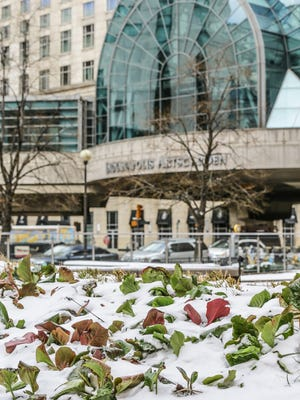 Snow blankets a garden outside of the PNC Center near the Indianapolis Arts Garden in downtown Indianapolis on Wednesday, March 21, 2018.