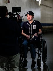 Kyle Van Houten of Hartland, is interviewed by Detroit Tigers' scoreboard department Nick Austin at the service level of the Comerica Park in Detroit, Friday, April 20, 2018.