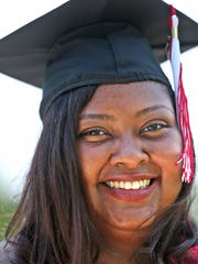 Porshea Johnson dons her graduation cap and gown in the Kennedy-King neighborhood park, Friday, May 11, 2018. The single mom was homeless and moved into Dayspring Center in 2012. She is graduating this weekend from IUPUI