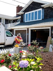 Workmen are shown at 312 East Avenue in Bay Head Tuesday,