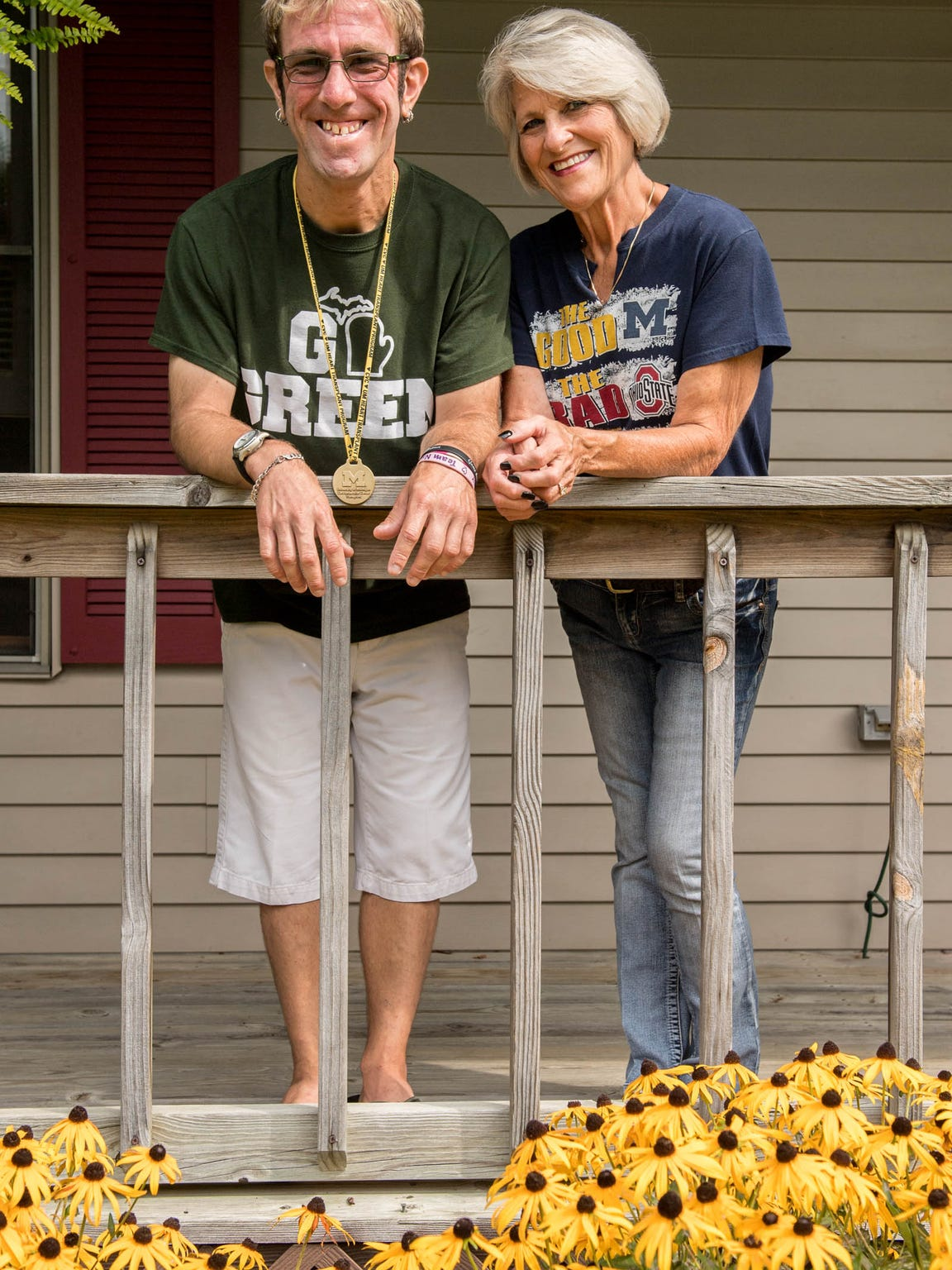Brian Stricklin, 31, the longest surviving heart transplant recipient from Michigan Medicine, the academic medical center at the University of Michigan, stands with his mom, Jackie Stricklin.