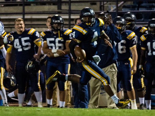 FILE -- Carencro quarterback Gabriel Duffy (4) sprints along the sideline on a long gain during a 2015 game.