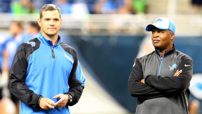 Detroit Lions offensive coordinator Joe Lombardi, left, watches practice at Ford Field on Aug. 6, 2014.