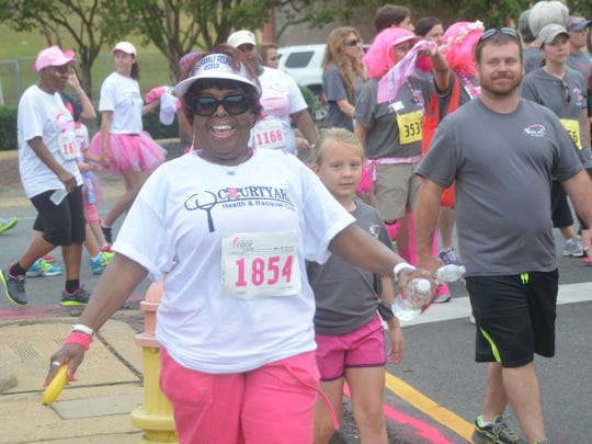 "Judy Franklin walks in the 5th annual CenLa Komen Race for the Cure held Saturday. ""I want so much that they find a cure in my lifetime,"" said Franklin as she walked. ""I support it 100 percent,"" she added. ""I want to see people happy and healthy."""