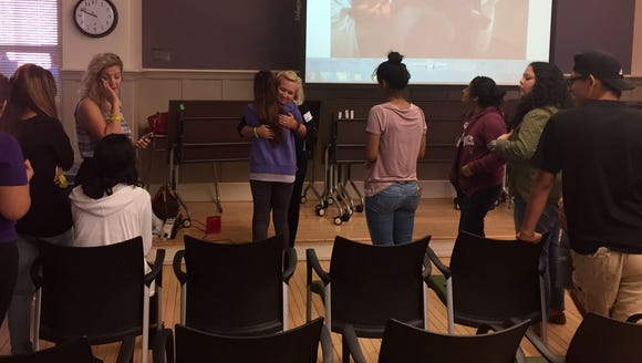 LeAnn Hull hugs students after her talk about suicide