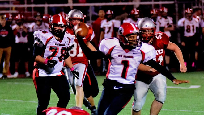 New Richmond quarterback Josh Anderson was sacked on this play by Goshen's Jordan Ulrey, but still led his team to victory.