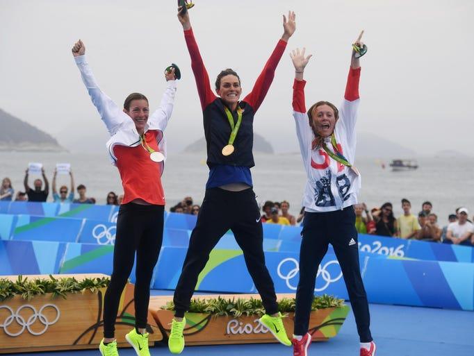 American Gwen Jorgensen (center) leads silver medalist