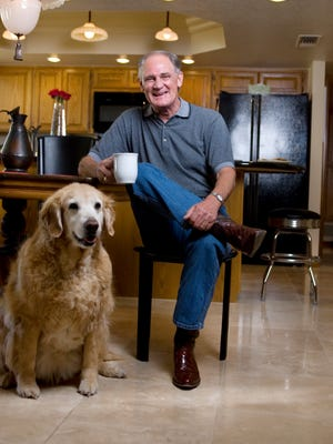 Dave Munsey enjoys a cup of coffee with his dog, Katie-Kay.