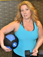 Connie Johnson gets in some functional training at the Planet Fitness in Milford.