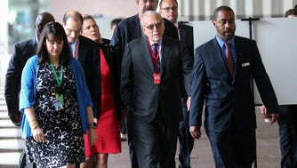 Trian Partners CEO Nelson Peltz, center, and other attendees walk into the Procter & Gamble headquarters for the annual shareholders meeting, Tuesday, Oct. 10, 2017, in Cincinnati. Peltz is seeking a board seat at Procter & Gamble after the company rejected his request for one after months of meetings.