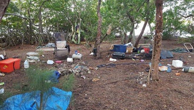 Island turned into makeshift camp near Alma Lee Loy Bridge, Vero Beach.