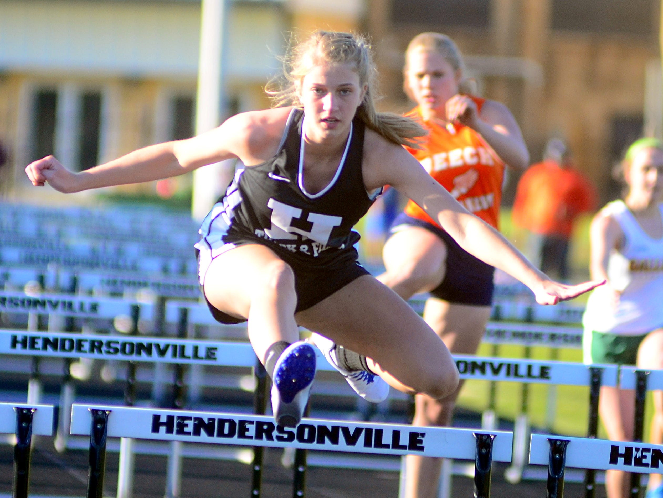Hendersonville High sophomore Brooke Long runs in a 100-meter hurdles qualifying heat. Long won the girls' high jump with a best effort of 4 feet, 9 inches.