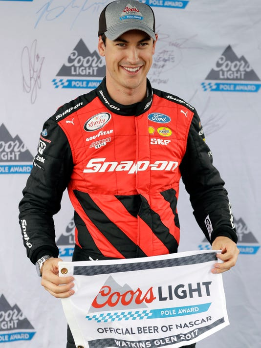 Joey Logano poses after qualifying on the pole for the NASCAR Xfinity Series auto race, Saturday, Aug. 5, 2017, in Watkins Glen, N.Y. (AP Photo/Matt Slocum)