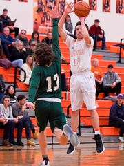 Northville's Kevin Morrissey (right) launches a jumper