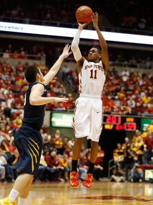 Iowa State's Monte Morris (11) shoots for three over West Virginia's Chase Connor (10) Saturday, Feb. 14, 2015, during the Cyclones 79-59 win over the Mountaineers at Hilton Coliseum in Ames. A foul was called on Iowa during the play and shot was called back.