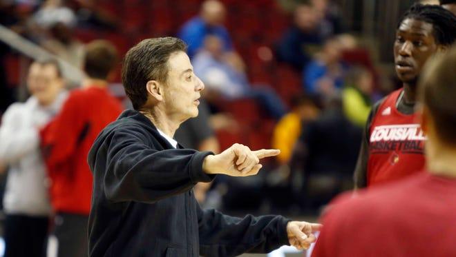Louisville coach Rick Pitino gives instruction during practice at KeyArena.