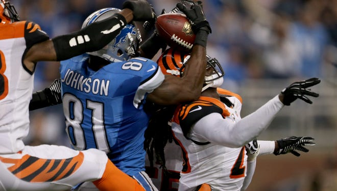 Detroit Lions wide receiver Calvin Johnson makes a touchdown catch against the Cincinnati Bengals on Oct. 20, 2013, at Ford Field.