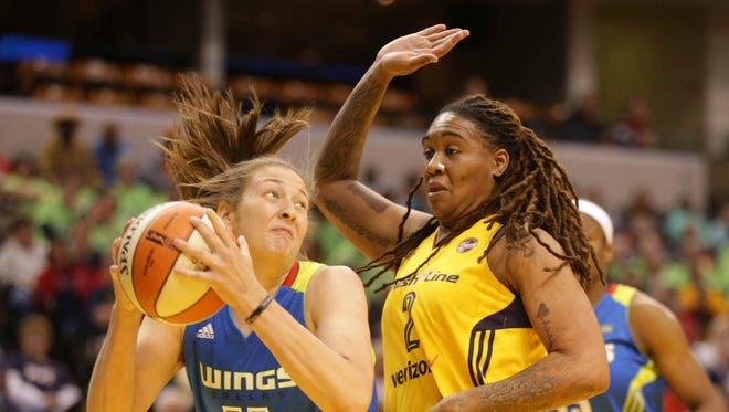 The Dallas Wing's Theresa Plaisance, left, and the Indiana Fever's  Erlana Larkins, right, grab for a rebound, Saturday May 14th, 2016. The Indiana Fever Played the Dallas Wings in their season opener at Bankers Life Fieldhouse.