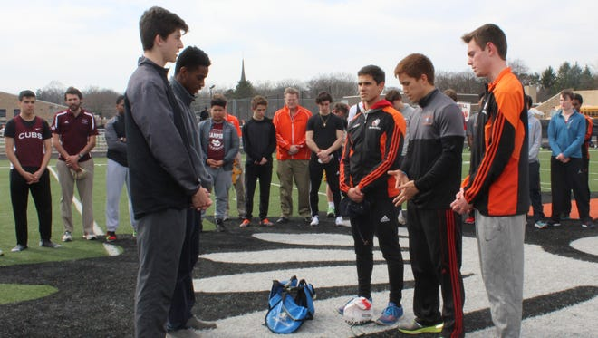 The U-D and Brother Rice track teams held a brief prayer service prior to their meet Monday for Sean English, the U-D junior recently injured in a car accident. The team captains included (left to right) Sean Butler and Donovan Erving (U-D) and Louie Forman, Liam Lynch and Kyle Chisholm (Brother Rice).