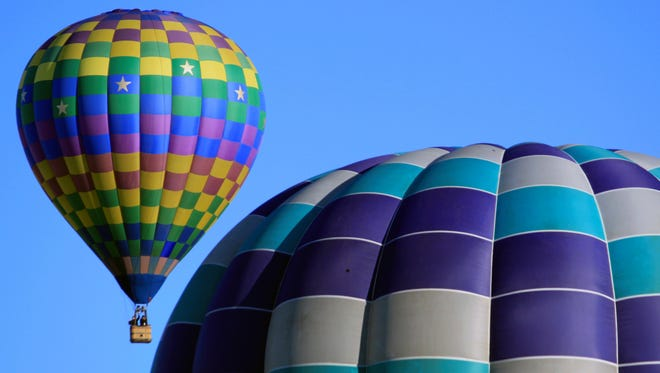 "Hot air balloons take part in the Albuquerque International Balloon Fiesta over Albuquerque, New Mexico, on Oct. 10, 2017. On April 17, the Muskego Public Library will be hosting ""Balloons on the Rise,"" a presentation by Gregg Trojanowski about a recent road trip to the festival."