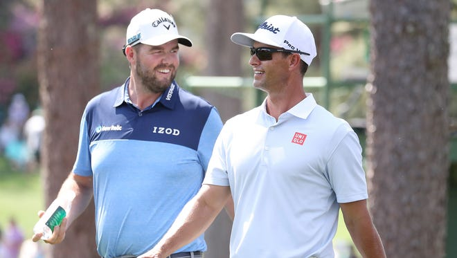 Marc Leishman (L) and Adam Scott of Australia on the 17th hole during the second practice round at the 2018 Masters Tournament at Augusta National Golf Club in Augusta, Ga.