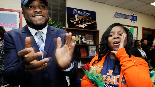 Pearl-Cohn football player Ke'Shawn Vaughn celebrates his mother Tameka Dennis after announcing he is playing football for University of Illinois at a signing day ceremony the school on Feb. 4, 2015.