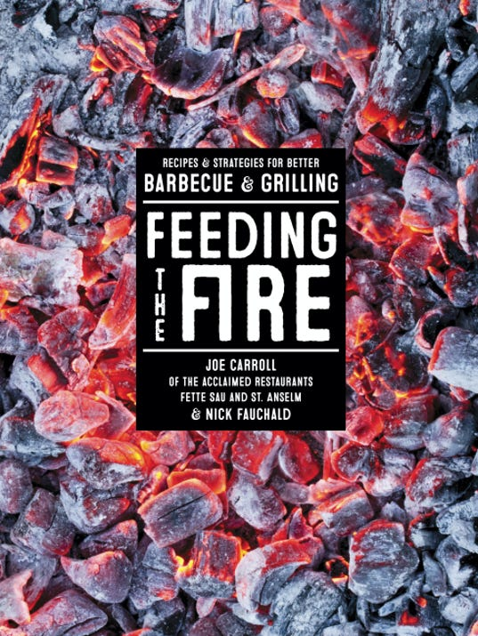 "This image provided by Artisan Books on April 7, 2015 shows the cover of the book ""Feeding the Fire"" by Joe Carroll. (AP Photo/Artisan Books)"
