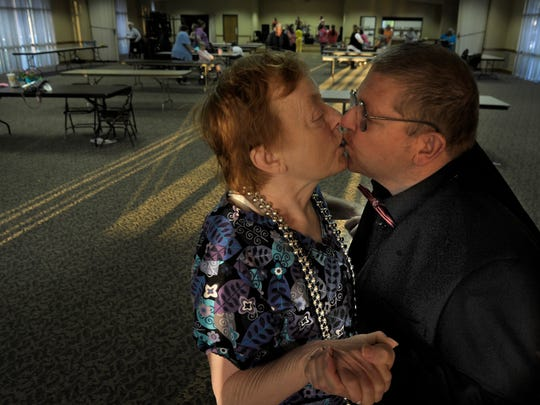 Coy and Rosemary Maness share a kiss at a Dickson County spring dance for people with intellectual disabilities.