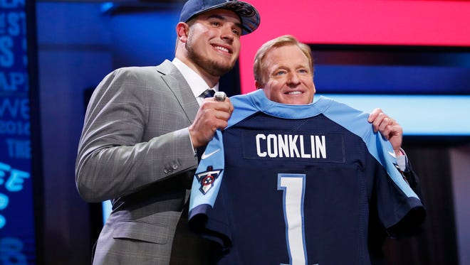 Former Michigan State offensive lineman Jack Conklin, with NFL commissioner Roger Goodell, was the No. 8 pick in the first round by the Tennessee Titans in 2016. The 2018 draft begins Thursday, April 26 at 8 p.m.
