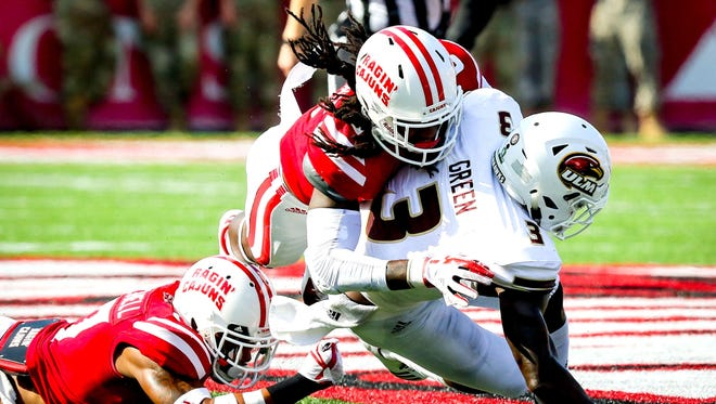 UL defensive back Corey Turner, on top, gets in on the action against UL Monroe last season. Turner is expected to be a leader of the Ragin' Cajuns defense in 2018.