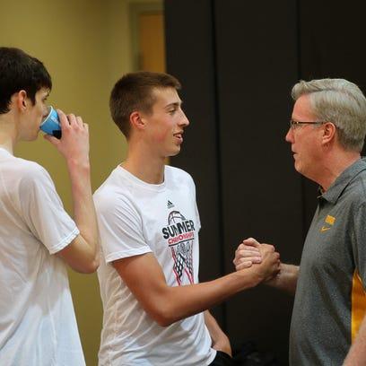 Iowa head coach Fran McCaffery greets Joe Wieskamp