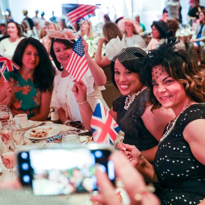 Guests take photos with British and American flags
