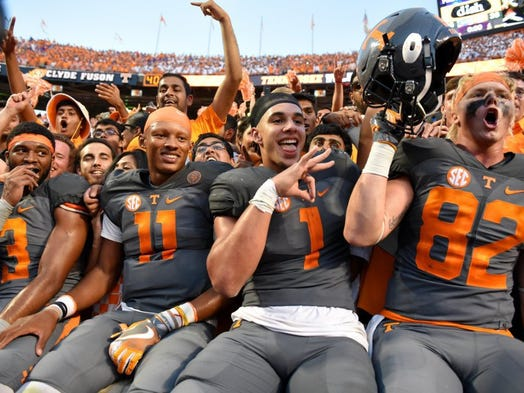 Tennessee wide receiver Josh Malone (3), quarterback Joshua Dobbs (11), running back Jalen Hurd (1), and tight end Ethan Wolf (82) celebrate their 38-28 win over Florida Saturday, September 24, 2016 at Neyland Stadium in Knoxville, Tenn.