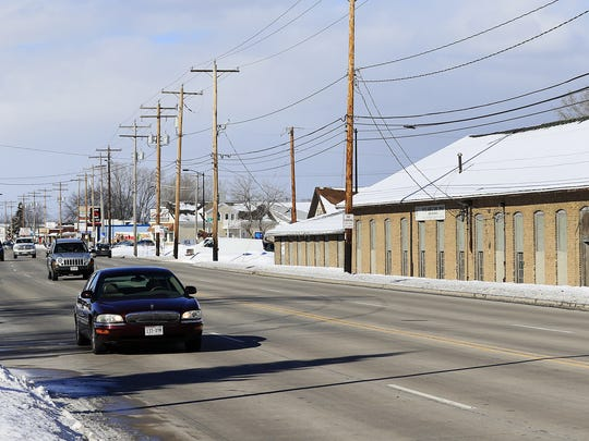 Traffic passes by the former Packer Manufacturing Co. building at 1222 Velp Ave., a site the city of Green Bay hopes will be improved as part of a plan to upgrade the area.
