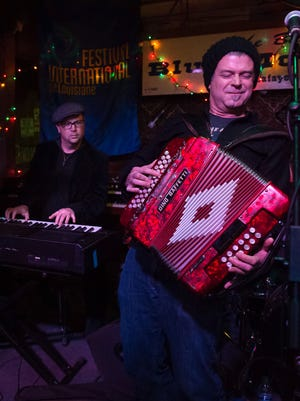 Eric Adcock, left, and Steve Riley of Orchestre Royal jam at the Blue Moon Saloon in downtown Lafayette.