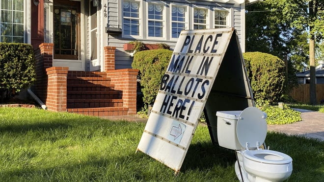 A political display set up in the lawn of a home on West Columbia Street in Mason, Mich., is seen Friday, Sept. 18. Ingham County Clerk Barb Byrum contends this display is inappropriate and possibly illegal.